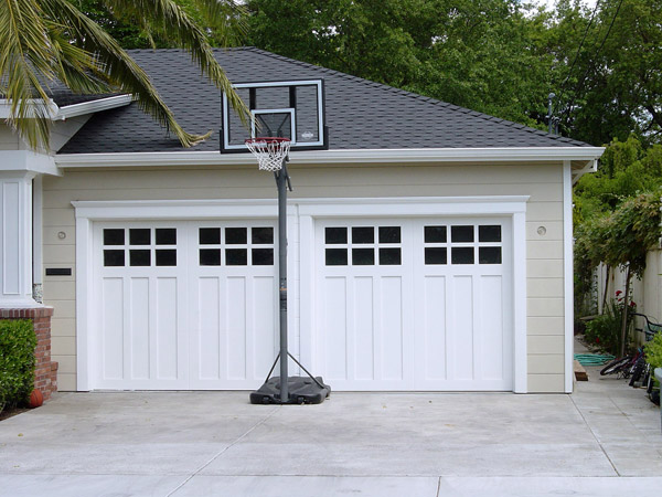 Custom wood carriage house garage doors beautiful solid for Carriage type garage doors